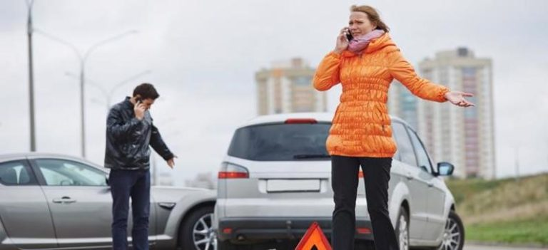 woman on the phone after a car accident