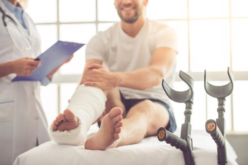 A man with an ankle injury from a poorly maintained property.
