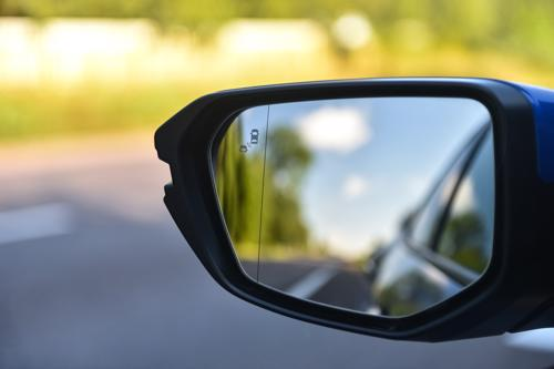 A close up photo of a car's rear view mirror.