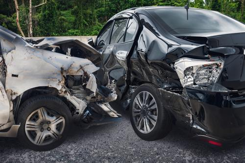 Two cars with extensive damage after a Buffalo Uber accident.