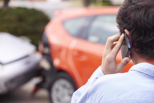 A man calling an attorney after a car accident in Long Island.
