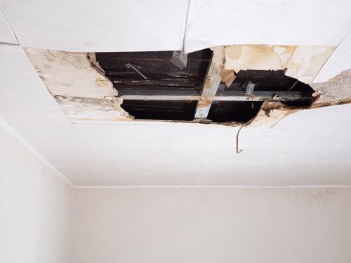 A photo of a collapsed section of ceiling, an issue that could easily lead to injuries of someone on the property.