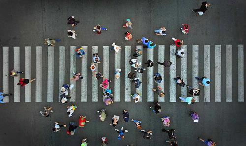 An overhead photo of a busy pedestrian crosswalk.