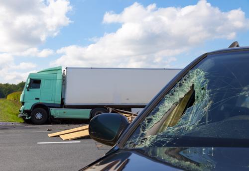 An accident between a tractor-trailer and a pickup truck.