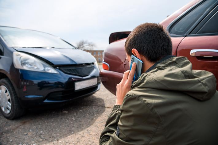A man callin a lawyer after a rear-end car accident in Rochester.