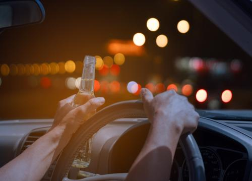 A person drinking while driving. An action that greatly increases their chance of causing an accident.