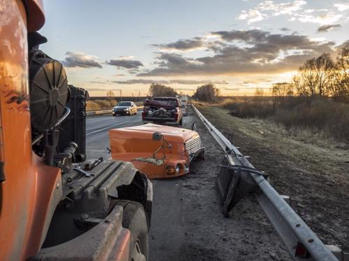 The aftermath of a truck accident in Rochester that left pieces of both the truck and car scattered on the side of the road.
