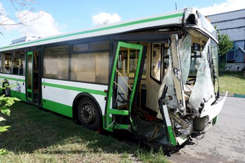 A bus with extensive damage after an accident.