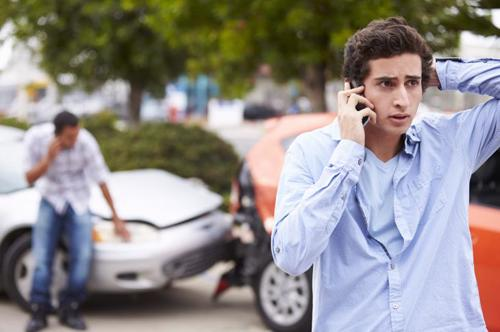 A man calling a Brookhaven car accident lawyer after being rear-ended.