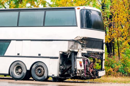 A photo of a bus with extensive damage after an accident.