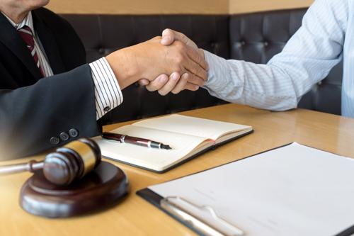 A person meeting with a Buffalo construction accident lawyer to file an injury claim.