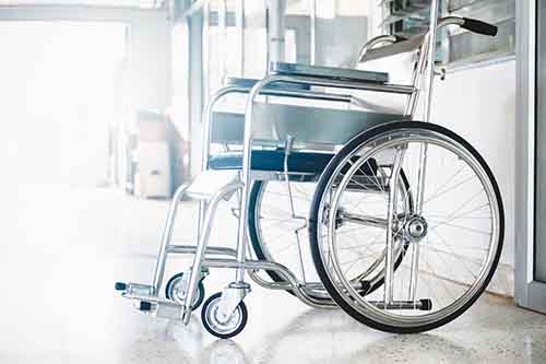 This image shows a wheelchair. Contact a Garden City spinal cord injury lawyer at Cellino Law for a free case evaluation.