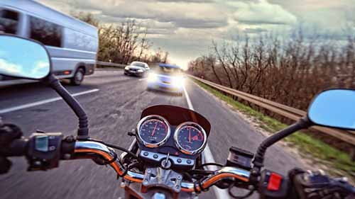 Moment before a motorcycle crash. If you need a Garden City motorcycle accident lawyer, call Cellino Law today.