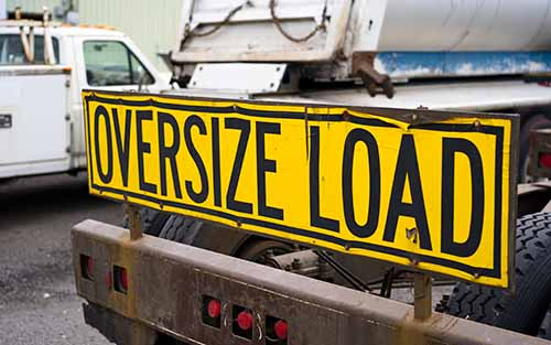 Truck with oversize load sign. Contact a Garden City truck accident lawyer at Cellino Law if you were in a crash caused by a negligent driver.