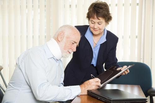 A Cheektowaga personal injury lawyer reviewing a settlement offer with a client.