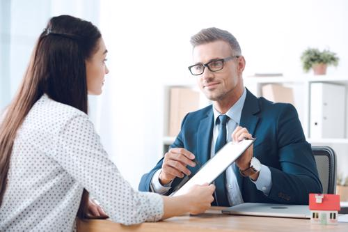 An attorney meeting with a woman for a slip and fall claim.