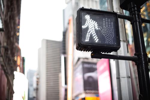 A light indicating it is safe for pedestrians to cross the street.