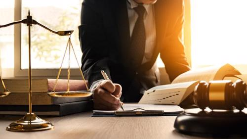 A Melville spinal cord injury lawyer filing a claim for a client.
