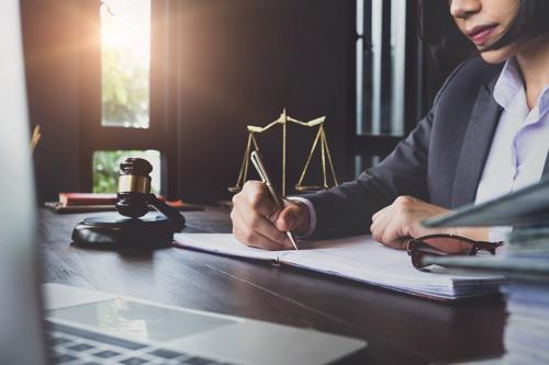 A New York City wrongful death lawyer filing an injury claim for a client.