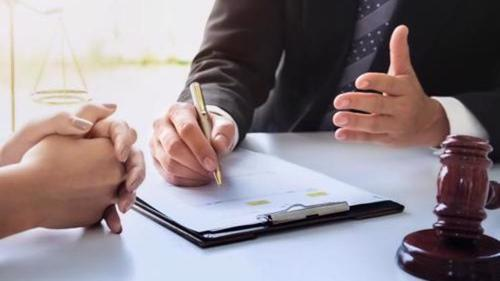 A New York City personal injury lawyer reviewing a settlement offer with a client.