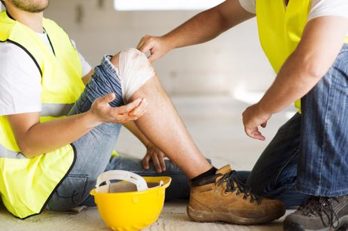 A construction worker having a knee injury treated.