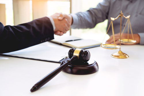 Clarkstown car accident lawyer shaking hands for settlement agreement