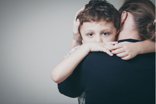Woman hugging son, loss of parent concept
