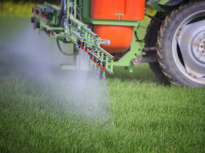 Spraying fields with Paraquat Weed Killer, a substance linked to Parkinson's disease